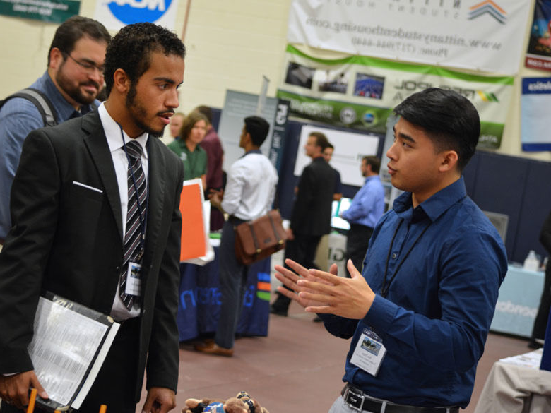 Student talking to a recruiter at job fair